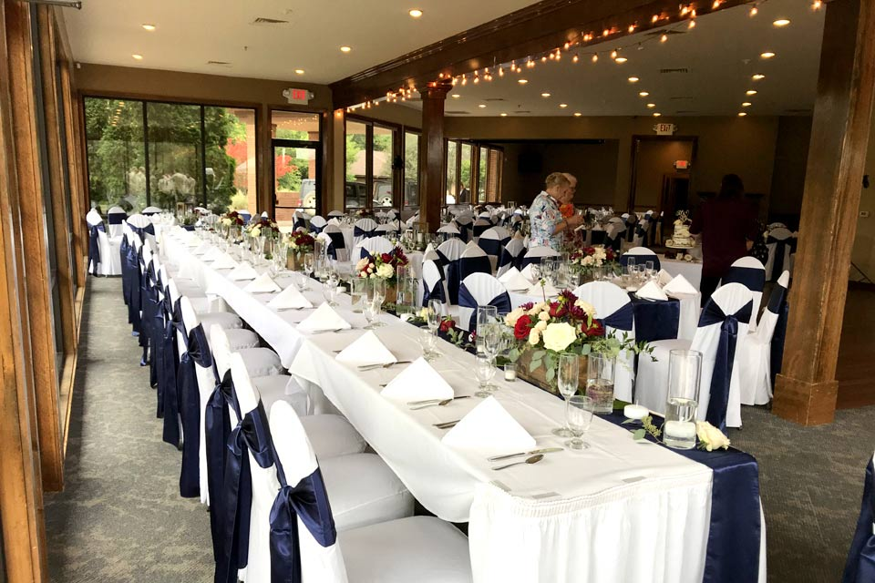 Head table with chair covers in Ann Arbor
