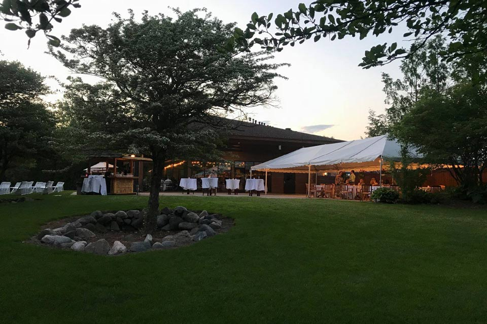 Outdoor wedding ceremony space in Ann Arbor with banquet room & tent